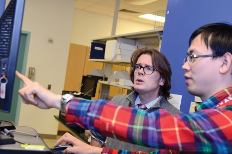Dr. B.A. Wilhite and doctoral student Haomiao Zhang discuss experimental results for Computer-Aided Design and Discovery of Energy Materials
